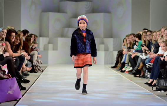 A young model shows off Kenzo's SS13 designs