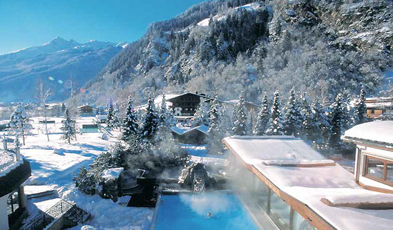 Spa Facilities - Relax in the indoor or outdoor pool with views of the Tyrol mountains