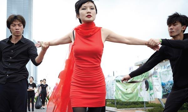 'Paper Rain Parade' Hong Kong artist Angela Su performs during Art Basel Hong Kong in 2013