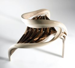 Irish designer Joseph Walsh created his Enignum III Chair by stripping wood into thin layers in order to manipulate them into freeform, undulating compositions which he then combined with copper and woven silk to create the striking, sculptural piece that is almost too beautiful to use. josephwalshstudio.com