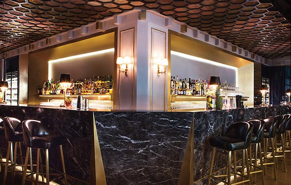 Reminiscent of elaborate jewellery from the 1920s, the marble bar at CICADA UltraLounge is the longest in town