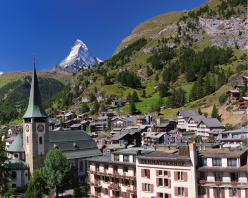 Peak Season: The village of Zermatt wears a cloak of green throughout the summer months, but the jagged Matterhorn retains its mantle of snow and ice