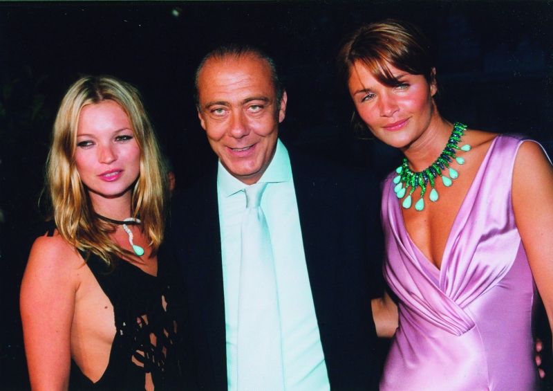 Models Kate Moss and Helena Christensen pictured with Fawaz Gruosi
